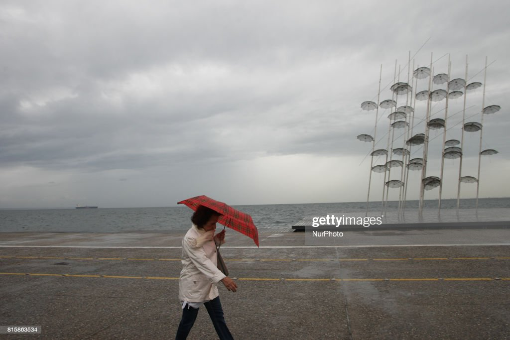 People walks in Thessaloniki, Greece, on July 17, 2017 during a rainy day.