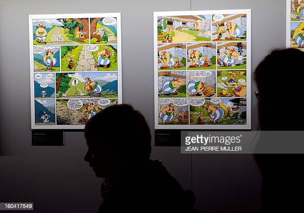 People walks past Asterix comics boards on January 31 2013 on the opening day of the 40th edition of the Angouleme International Comics Festival in...