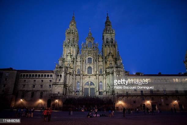 People wander near Santiago de Compostela Cathedral where a funeral mass will be held on July 29 for the recent train crash victims on July 28 2013...