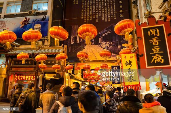 People wandering around underneath chinese lanterns in Wangfujing Street in Chinas capital Beijing