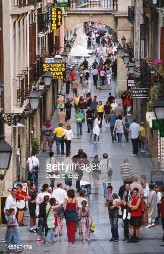 People wandering narrow streets of old town. : Stock Photo