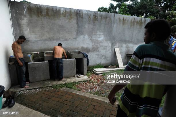 People wash their clothes at the shelter for immigrants Albergue Decanal Guadalupano in Tierra Blanca Veracruz Mexico on August 21 2010 Central...