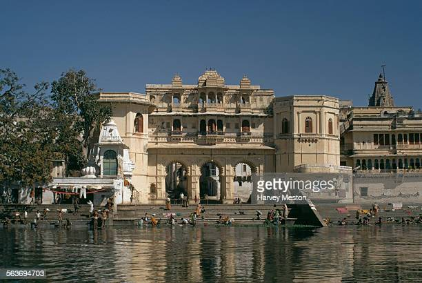 People washing clothes at the bathing ghat in Udaipur Rajasthan India 1972