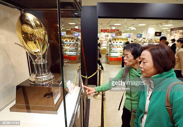 People watch a 389 million yen pure gold 'rugby ball' at Takashimaya Co department store in the western Japan city of Osaka on Nov 17 2016 A 432...