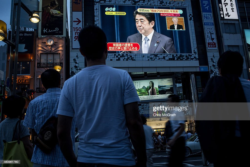 People watch a big screen showing a live broadcast of Japanese Prime Minister, Shinzo Abe as he delivers his WWII Anniversary Statement on August 14, 2015 in Tokyo, Japan. Japanese Prime Minister Abe delivered a war anniversary statement ahead of the anniversary of Japan's defeat in the second world war. The statement included such keywords as 'apology from the heart,' 'colonial rule,' and 'aggression.'