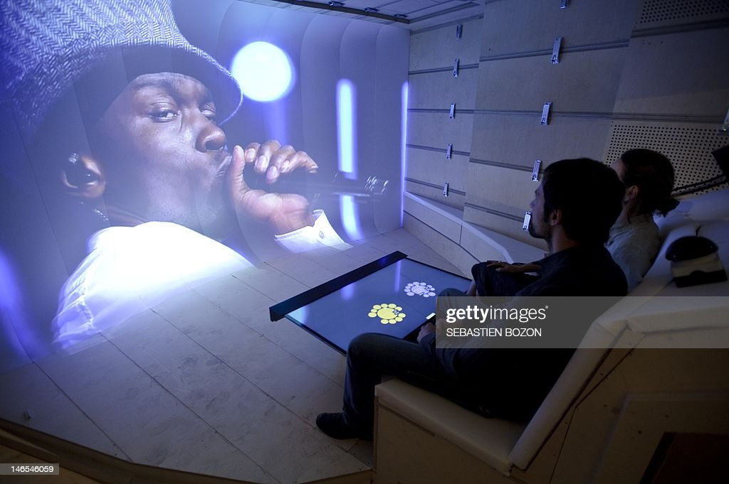 People watch a concert video on June 19, 2012 in Renens inside the Montreux Jazz Heritage Lab, the first platform for playing the digitized media of 45 years of Montreux Jazz concert archives. AFP PHOTO / SEBASTIEN BOZON