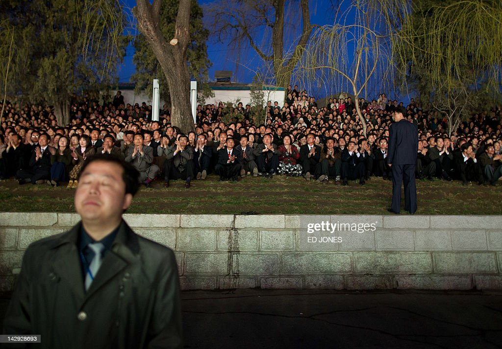 People watch a fireworks display to mark 100 years since the birth of North Korea's founder Kim Il-Sung in Pyongyang on April 15, 2012. North Korea's new leader Kim Jong-Un delivered his first public speech and vowed to push for 'final victory' for his impoverished state despite a failed rocket launch two days ago, as the country celebrated the 100th anniversary of former leader Kim Il-Sung. AFP PHOTO / Ed Jones