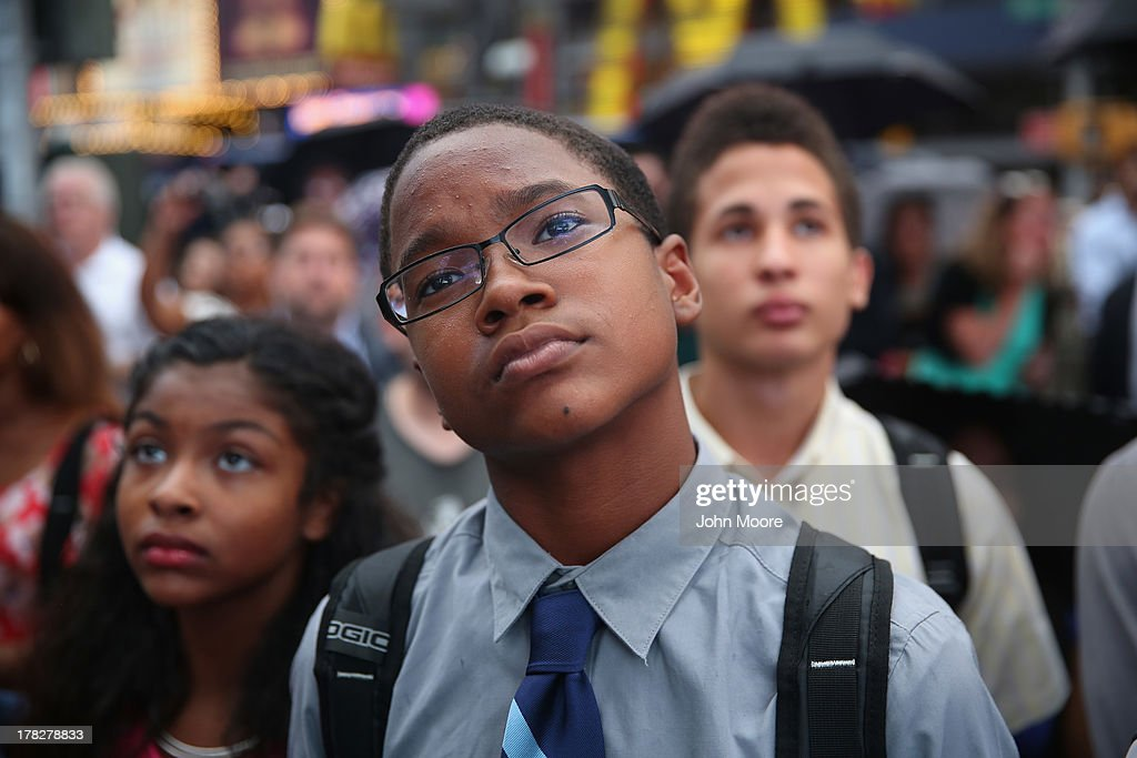 People watch a giant screen in Times Square as U.S. President Barack Obama speaks on the 50th anniversary of Martin Luther King Jr.'s 'I Have a Dream' speech on August 28, 2013 in New York City. With the official ceremony in Washington D.C., a crowd gathered in Manhattan's Times Square to watch the President's speech broadcast live and commemorate the anniversary of what is seen as one of the most important days in the history of American civil rights.