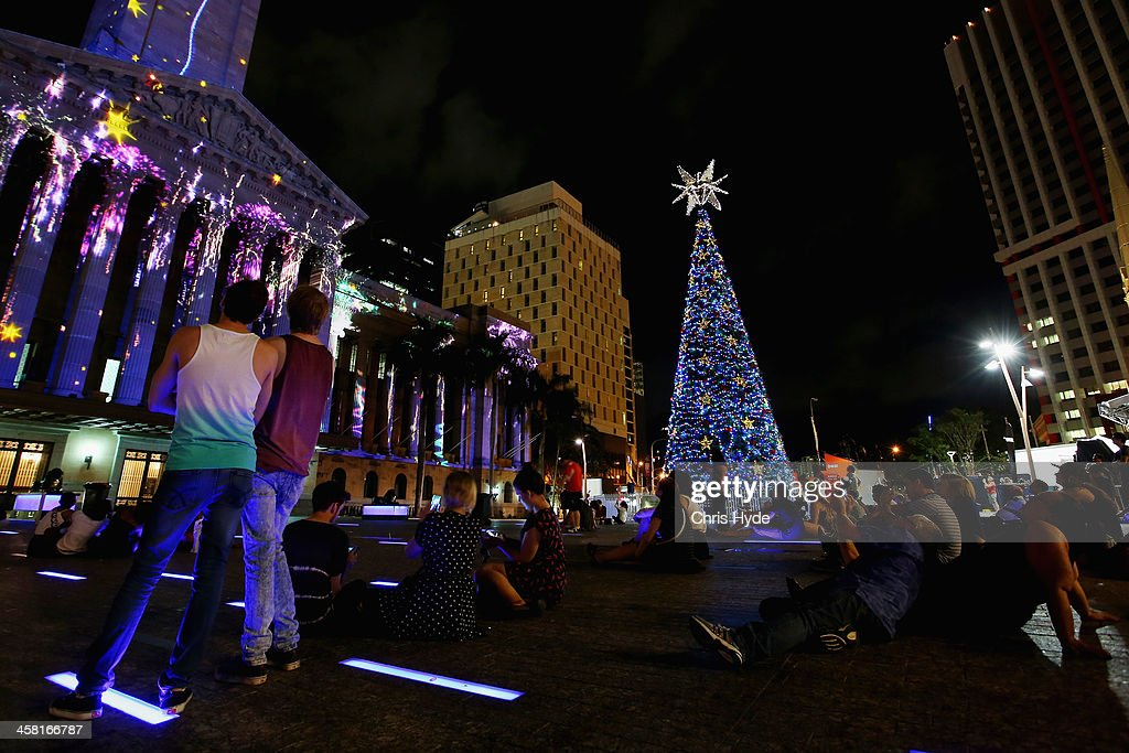 people watch a light show in front of a 20m solar powered christmas