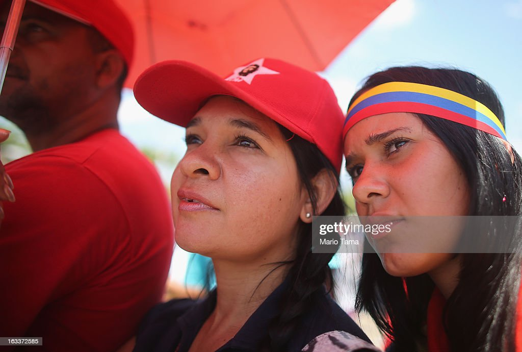 People watch a live broadcast of the funeral for Venezuelan President Hugo Chavez outside the Military Academy on March 8, 2013 in Caracas, Venezuela. Countless Venezuelans have paid their last respects to Chavez and more than 30 heads of state were expected to attend the funeral today.