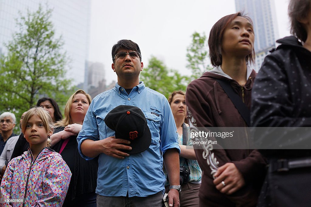 People watch a live video from the Ground Zero memorial site of the dedication ceremony of the National September 11 Memorial Museum in New York May 15, 2014 in New York City. The museum spans seven stories, mostly underground, and contains artifacts from the attack on the World Trade Center Towers on September 11, 2001 that include the 80 ft high tridents, the so-called 'Ground Zero Cross,' the destroyed remains of Company 21's New York Fire Department Engine as well as smaller items such as letter that fell from a hijacked plane and posters of missing loved ones projected onto the wall of the museum. The museum will open to the public on May 21.
