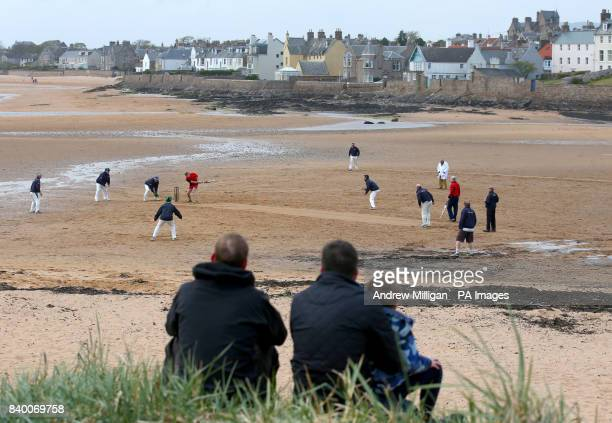 People watch a match between the Ship Inn Cricket Club and the Eccentric Flamingoes Cricket Club on Sunday April 30th in front of the pub in Elie...