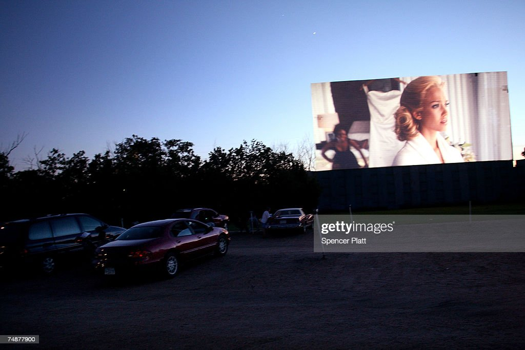 People watch a movie at the Kearney Drive-In June 24, 2007 in Kearney, Nebraska. Since its opening in 1952, the Kearney Drive-In remains popular among families, as children are not charged admission, but may close next year due to the lease expiration. Kearney Drive-In is one of the only two drive-in movie theaters left in the state of Nebraska from over fifty. Drive-in movie theatres were once a symbol of American road culture but most of them are closing in recent years as more Americans prefer go to Megaplexes or watch movies at home.