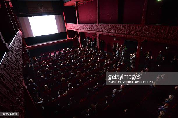 People watch a movie at the world's oldest cinema theater 'L'Eden' during its official reopening on October 9 2013 in La Ciotat southern France AFP...