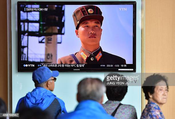 People watch a news report at a railway station in Seoul on September 15 on the confirmation from North Korea that the nuclear reactor seen as the...