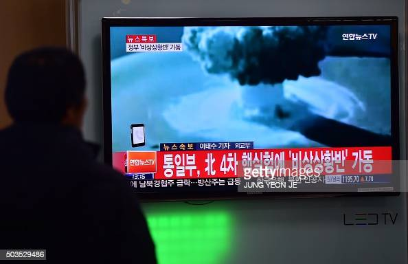 People watch a news report on North Korea's first hydrogen bomb test at a railroad station in Seoul on January 6 2016 South Korea 'strongly'...