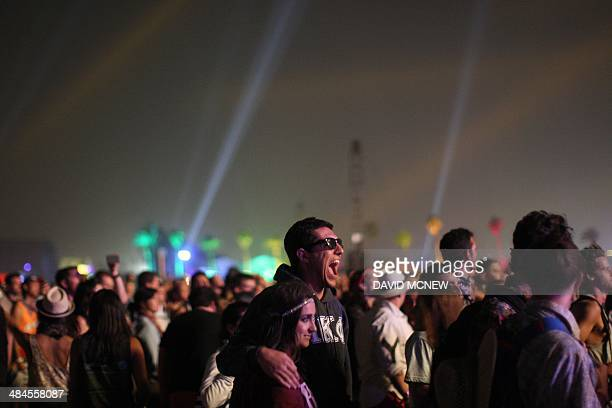 People watch a performance at the Coachella Valley Music Arts Festival at the Empire Polo Club in Indio California April 12 2014 The annual music...