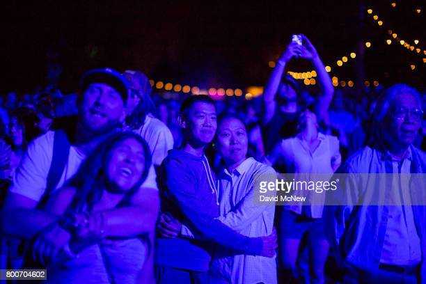 People watch a performance by Tom Petty and the Heartbreakers during Arroyo Seco Weekend at the Brookside Golf Course at on June 24 2017 in Pasadena...