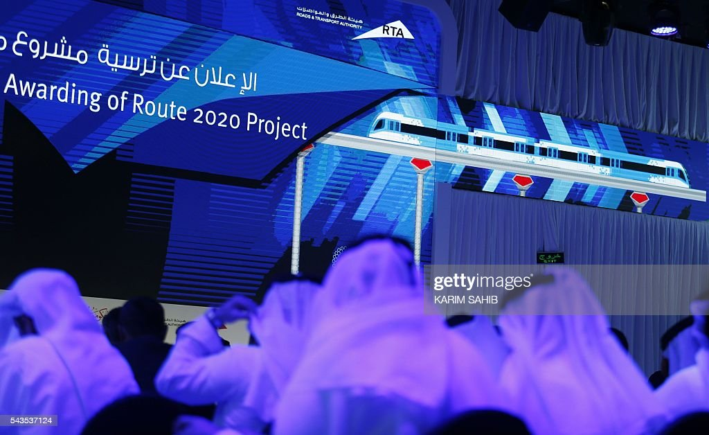 People watch a presentation of the Route 2020 metro expansion project during a press conference on June 29, 2016, in the emirate of Dubai. Dubai's transport authority announced it had awarded a French-led consortium a $2.88 billion contract to extend its metro network to the site of the Expo 2020 world trade fair. The consortium, led by France's Alstom Conglomerate and also including Spain's Acciona and Turkey's Gulermak, will construct a 15 kilometre (nine mile) extension to the site of the fair, a statement said. / AFP / KARIM