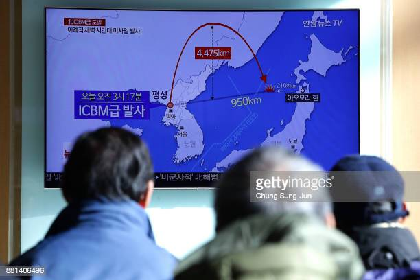People watch a television broadcast reporting North Korea's testlaunch of its new ICBM at the Seoul Railway Station on November 29 2017 in Seoul...