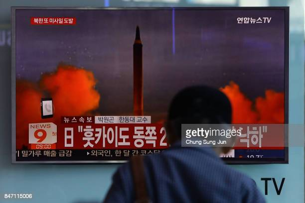 People watch a television broadcast reporting the North Korean missile launch at the Seoul Railway Station on September 15 2017 in Seoul South Korea...