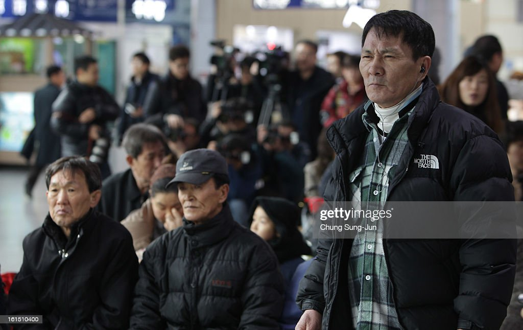 People watch a television broadcast reporting the North Korea's nuclear test at the Seoul Railway station on February 12, 2013 in Seoul, South Korea. North Korea confirmed it had successfully carried out an underground nuclear test, as a shallow earthquake with a magnitude of 4.9 was detected by several international monitoring agencies. South Korea and Japan both assembled an emergency meeting of their respective national security teams after the incident.