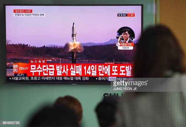 People watch a television news showing file footage of a North Korean missile launch at a railway station in Seoul on April 5 2017 Nucleararmed North...