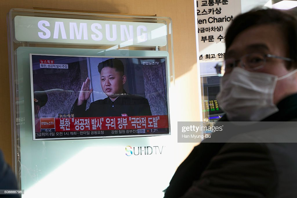 People watch a television screen showing a breaking news on North Korea's long-range rocket launch at Seoul Station on February 7, 2016 in Seoul, South Korea. North Korea launched a long-range rocket carrying a satellite on February 7, 2016. The launch is considered by Western experts as part of a program to develop intercontinental ballistic missile technologies, banned by the multiple of past resolutions of the U. N. Security Council against the country. South Korea, the United States and Japan have requested an emergency meeting of the U.N. Security Council.