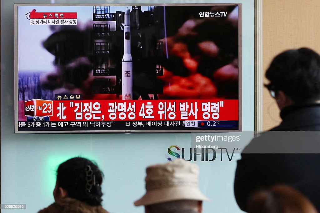 People watch a television screen showing a news broadcast on North Korea's long-range rocket launch at Seoul Station in Seoul, South Korea, on Sunday, Feb. 7, 2016. North Korea launched a long-range rocket Sunday, just weeks after conducting a fourth nuclear test in the latest setback for international efforts to pressure the Kim Jong Un regime to end its weapons program. Photographer: SeongJoon Cho/Bloomberg via Getty Images