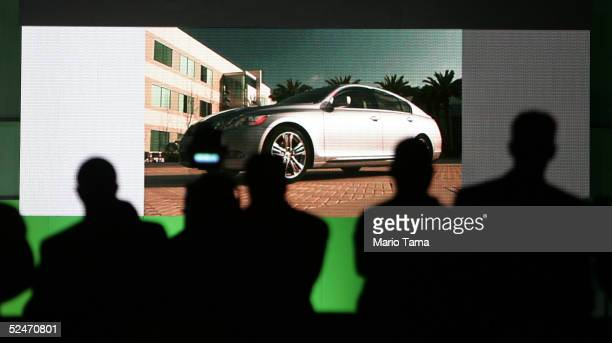 People watch a video presentation of the world premiere of the 2006 Lexus GS450h Hybrid at the 2005 New York International Auto Show March 23 2005 in...