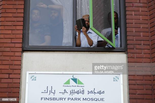 People watch a vigil from a window of the Finsbury Park Mosque in north London on June 20 following a van attack on pedestrians nearby on June 19 Ten...