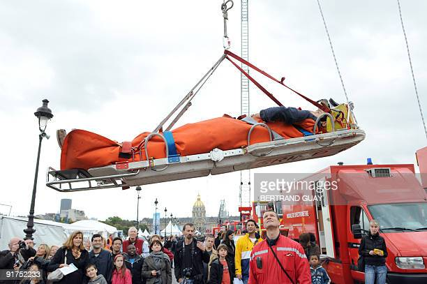People watch an exercise of firstaid with French firemen of Paris during the 'French national day of interior security' aimed at informing the public...