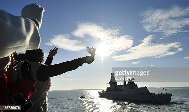 People watch and wave as the new British Royal Navy destroyer HMS Daring the first of the Royal Navy's new Type 45 destroyers leaves the southern...