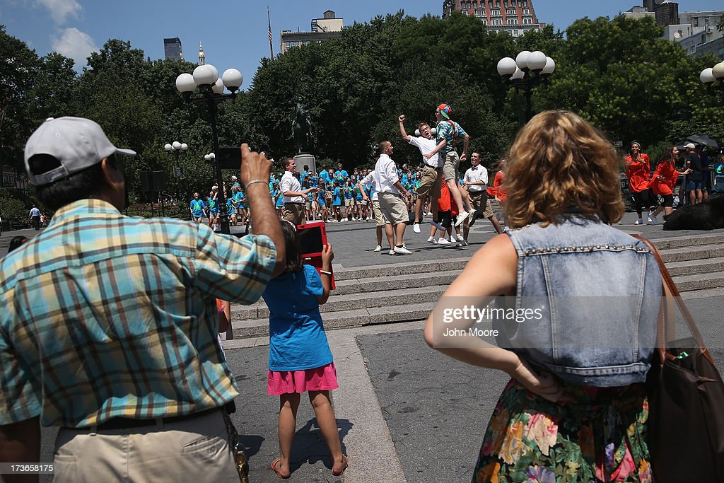 People watch as a Christian missionary group from Dallas performs a concert in Union Square Park on July 16, 2013 in New York City. Record temperatures soared over 100 degrees in the Northeast U.S., as a heat wave settled over most of the country.