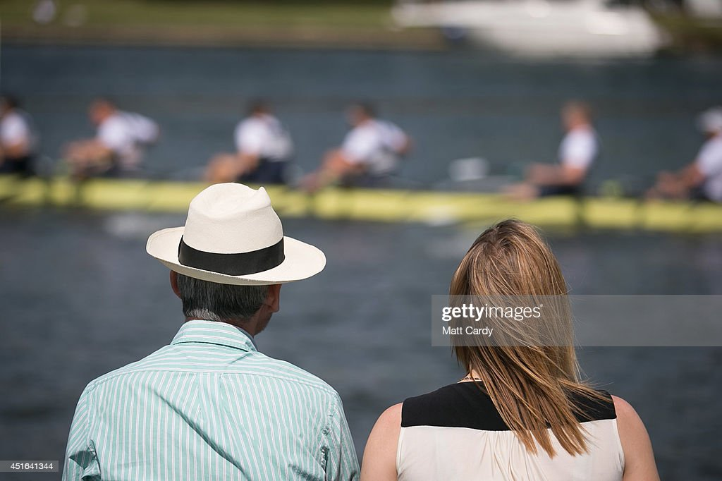 People watch as a crew competes in a race at the Henley Royal Regatta on July 3, 2014 in Henley-on-Thames, England. Opening yesterday and celebrating its 175th year, the Henley Royal Regatta is regarded as part of the English social season and is held annually over five days on the River Thames. Thousands of rowing fans are expected to come to watch races which are head-to-head knock out competitions, raced over a course of 1 mile, 550 yards (2,112 m) which regularly attracts international crews to race.
