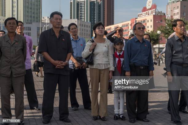 People watch as a screen shows footage of the launch of a Hwasong12 rocket in Pyongyang on September 16 2017 North Korea said on September 16 it was...