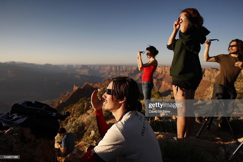 People watch as an eclipse reaches annularity as the moon passes before the sun in the first annular eclipse seen in the U.S. since 1994 on May 20, 2012 in Grand Canyon National Park, Arizona. Differing from a total solar eclipse, the moon in an annular eclipse appears too small to cover the sun completely, leaving a ring of fire effect around the moon. The eclipse is casting a shallow path crossing the West from west Texas to Oregon then arcing across the northern Pacific Ocean to Tokyo, Japan.