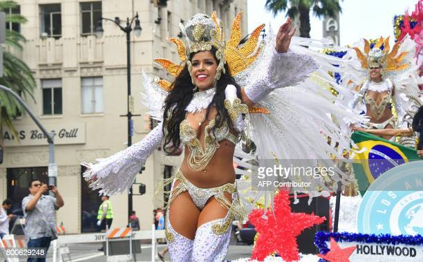 People watch as dancers make their way down Hollywood Boulevard at the 6th annual Hollywood Carnival Parade celebrating world cultures on June 24...