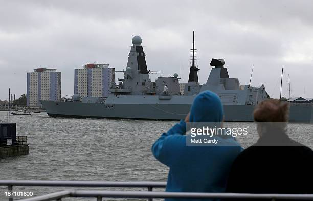 People watch as HMS Dauntless a Type 45 Destroyer that was built at Portsmouth dockyard leaves the HM Naval Base in Portsmouth dockyard home of BAE...