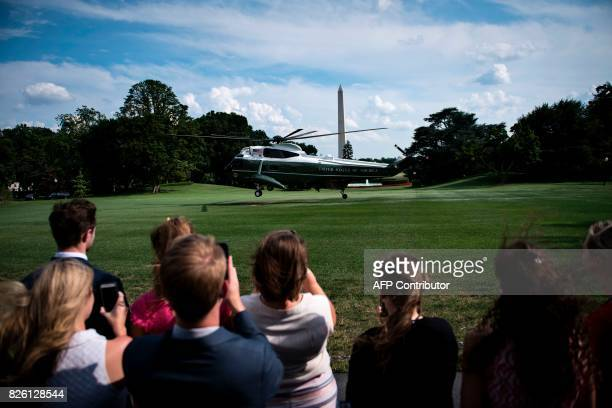 People watch as Marine One with US President Donald Trump departs the South Lawn of the White House August 3 2017 in Washington DC Special counsel...
