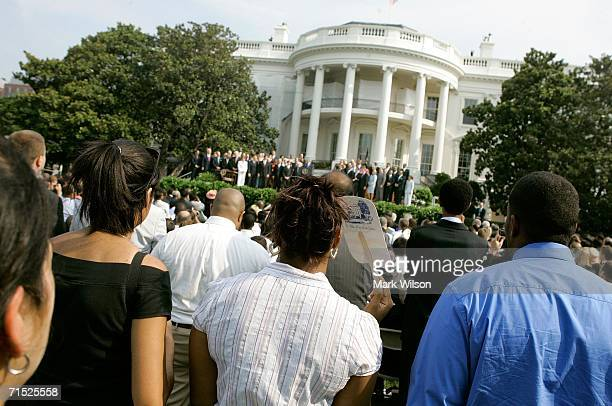 People watch as President Bush prepare to sign the Fannie Lou Hamer Rosa Parks and Coretta Scott King Voting Rights Act Reauthorization and...
