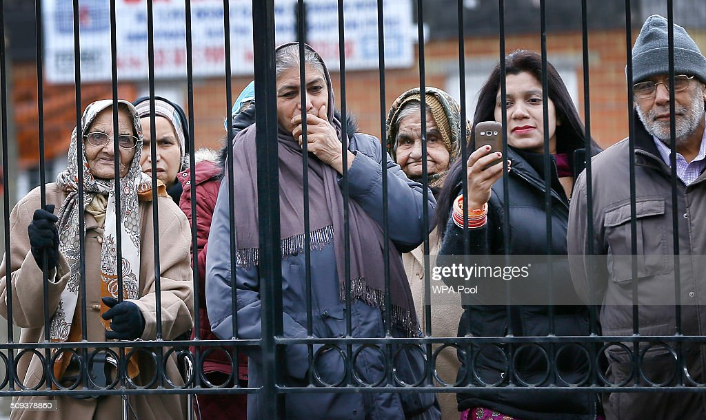 People watch as Prince Charles, Prince of Wales visits St John's Church on February 10, 2016 in Southall, England. The Prince met members of the congregation and heard about the church's inter-faith work and role in the local community.