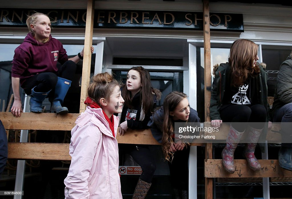 People watch as rival teams the 'Up'ards and Down'ards' battle for the ball during the annual Ashbourne Royal Shrovetide 'no rules' football match on February 9, 2016 in Ashbourne, England. Played since the 17th Century, the annual Shrovetide Football Match sees teams from opposite ends of the Derbyshire town of Ashbourne aim to get a ball into one of two goals that are positioned three miles apart at either end of Ashboune. The game has 'no rules' and can sometimes end in injury and damage to property although volunteer stewards keep a watchful eye for any serious foul play or possible damage. The match starts on Shrove Tuesday and can last until 10 PM. If a goal is scored before 6 PM then a new ball is 'turned up' again and a new game started. If the goal is after 6 PM then the game ends for that day and continues into the next day, known as Ash Wednesday.