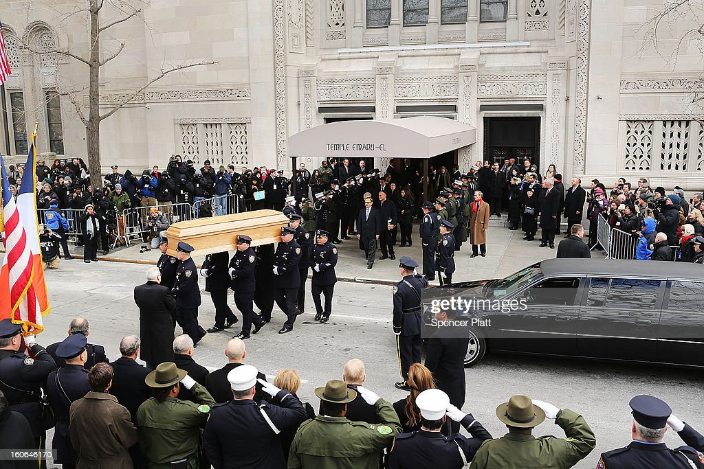 People watch as the casket of former New York City Mayor Ed Koch is brought out by members of the New York Police Department following funeral services at Manhattan's Temple Emanu-El on February 4, 2013 in New York City.The iconic former New York mayor passed away on February 1, 2013 in New York City at age 88. Ed Koch was New York's 105th mayor and ran the city from 1978-89. He was often outspoken and combative and has been credited with rescuing the city from near-financial ruin during a three-term City Hall run.
