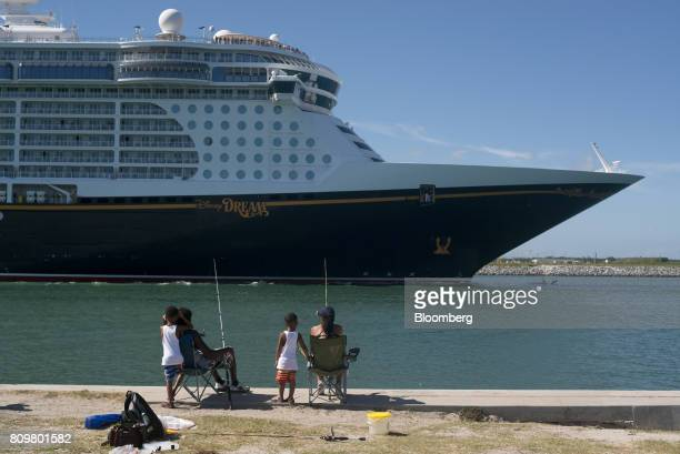 People watch as the Disney Dream cruise ship leaves from Port Canaveral in Cape Canaveral Florida US on Wednesday July 5 2017 The US Census Bureau...
