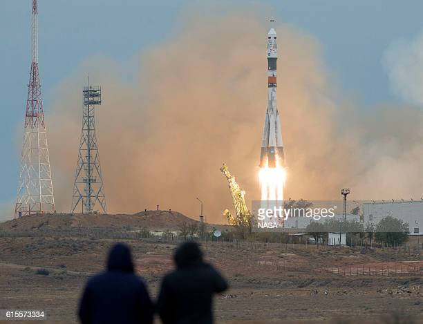 People watch as the Soyuz MS02 rocket is launched with expedition 49 Soyuz commander Sergey Ryzhikov of Roscosmos flight engineer Shane Kimbrough of...