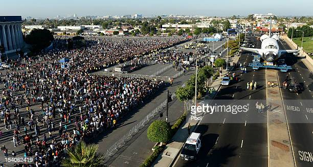 People watch as the Space Shuttle Endeavour arrives at the Forum enroute to the California Science Center on October 13 2012 in Inglewood California...