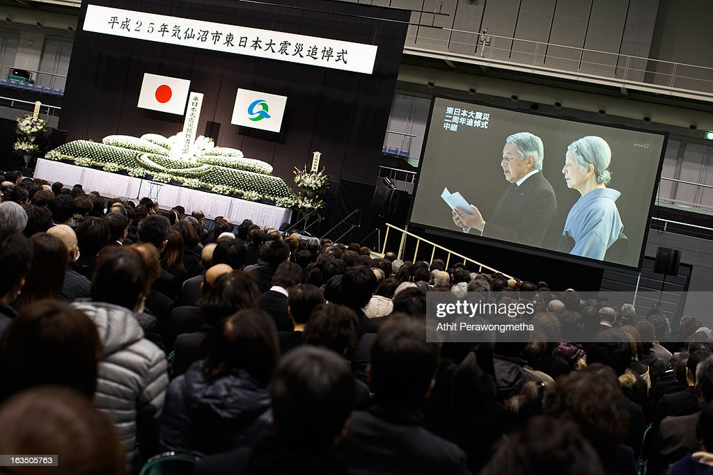 People watch Emperor Akihito and Empress Michiko projected on a large screen during a memorial ceremony to commemorate the victims of the 2011 earthquake and subsequent tsunami on March 11, 2013 in Kesennuma, Japan. Japan is commemorating the second anniversary of the 2011 Magnitude 9.0 earthquake and subsequent tsunami that claimed more than 18,000 lives.