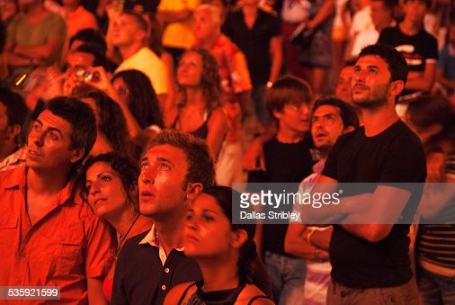 People watch fireworks during religious festival : Stock Photo