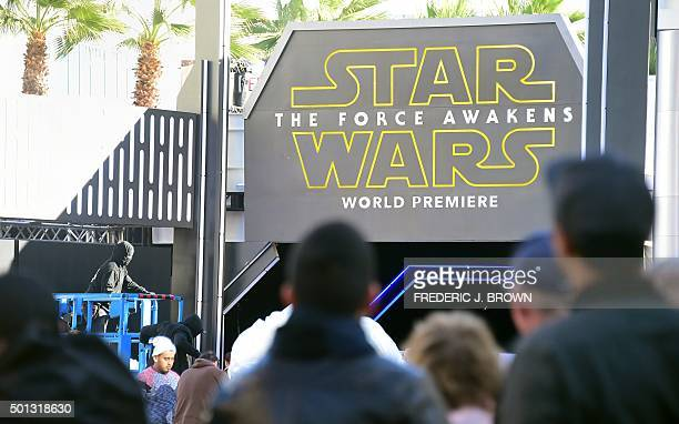 People watch from behind police barricades and closure of streets on December 14 2015 in Hollywood California as preparations take place for the...